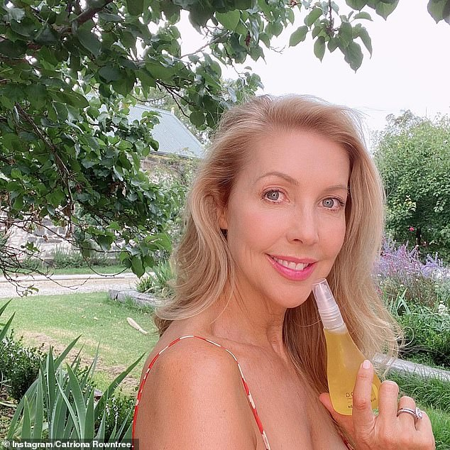 Getaway host Catriona Rowntree revealed the beauty product she swears by for 'glowing' skin and a luminous complexion, and it only costs $19.95 (Catriona pictured with the jojoba oil)